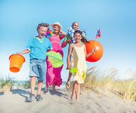 Cheerful Family Bonding by the Beach Royalty Free Stock Image