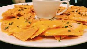Cheesy nachos Stock Image