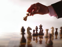 Chess and hand Stock Photos