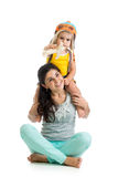 Child boy plays pilot sitting on mother shoulders Royalty Free Stock Image