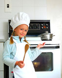 Child chef cooking Royalty Free Stock Photo