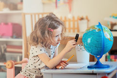 Child girl learning with globe at home Royalty Free Stock Image