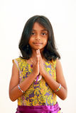 Child greeting with a traditional indian welcome Royalty Free Stock Image
