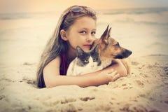 Child hugging pets Stock Image