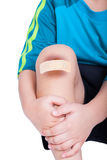Child knee with a plaster (for wounds) and bruise Stock Photos
