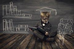 Child Little Boy in Glasses Reading Book over School Black Board Stock Image