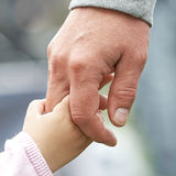 Child and parent holding hands Royalty Free Stock Photos