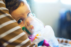 Child under medical treatment Royalty Free Stock Image