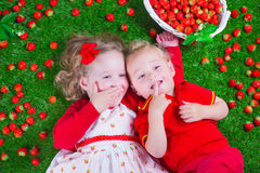 Children eating strawberry Stock Photos