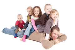 Children having fun playing with dad Royalty Free Stock Images