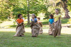 Children having a sack race in park Royalty Free Stock Image