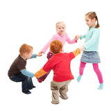 Children playing kids game holding hands in circle Stock Images