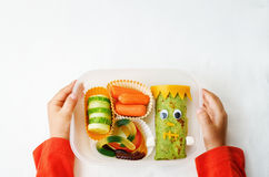 Childrens hands holding lunch box  for Halloween Stock Photos