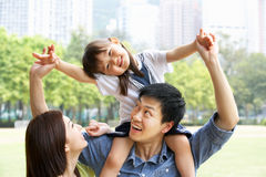 Chinese Family Giving Daughter Ride On Shoulders Stock Image