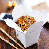 Chinese take out with smart phone on table and menu Stock Photography