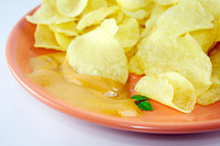 Chips and sauce Stock Images