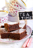 Chocolate brownies dusted with icing sugar Stock Images