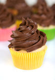 Chocolate cupcake in yellow wrapper Stock Photo