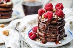 Chocolate pancake with bananas, raspberries, nuts and chocolate Stock Photo