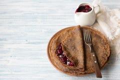 Chocolate pancakes with cherry sauce Stock Image