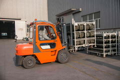 Chongqing Branch of Minsheng Logistics Baotou auto parts warehouse forklifts are operating Royalty Free Stock Photos