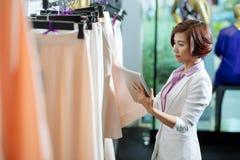 Choosing skirt Royalty Free Stock Images
