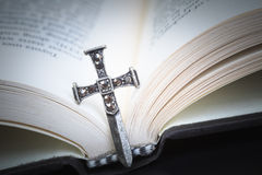 Christian cross necklace on Holy Bible book, Jesus religion conc Royalty Free Stock Image