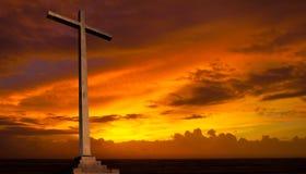 Christian cross on sunset sky. Religion concept. Royalty Free Stock Image
