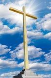 Christian gold cross on sky. Religion and faith concept. Stock Photo