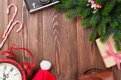 Christmas background with camera, alarm clock and tree branch Stock Image