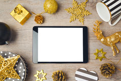 Christmas background with digital tablet and decorations. View from above Stock Photo