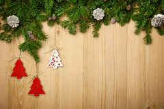 Christmas background with firtree, decorative trees and cones on Royalty Free Stock Photos