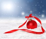 Christmas background with red bauble and merry christmas ribbon Royalty Free Stock Images