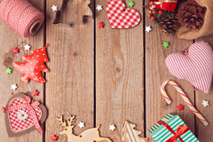 Christmas background with rustic Christmas decorations on wooden table. View from above Stock Photo