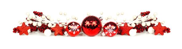 Christmas border of red and white branches and ornaments Royalty Free Stock Photography