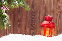 Christmas candle lantern and fir tree branch in snow Stock Images