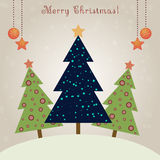 Christmas card with decorated fir trees Stock Images