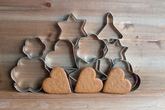 Christmas cookie cutters and gingerbread cookies Stock Image