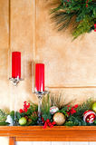 Christmas decorations on fireplace mantle Royalty Free Stock Image