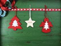 Christmas decorations on vintage green wood background, with hanging felt ornaments. Stock Image