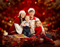 Christmas Family Four Persons, Mother Father Children, Red Royalty Free Stock Photos