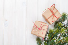Christmas fir tree with snow and gift boxes Stock Photo