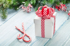 Christmas gift box, candy cane and fir tree Stock Photo