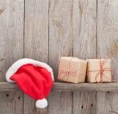 Christmas gift boxes and santa hat Stock Photography