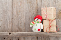 Christmas gift boxes and snowman toy Royalty Free Stock Image