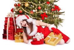 Christmas girl in santa hat holding red gift box. Royalty Free Stock Photo