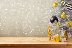Christmas holiday background with Christmas tree and decorations on wooden table. Black, golden and silver ornaments Stock Images