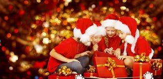 Christmas Kids Opening Present Gift Box, Children in Santa Hat Royalty Free Stock Photo