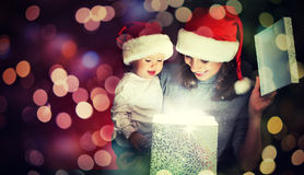 Christmas magic gift box and a happy family mother and baby Royalty Free Stock Photos