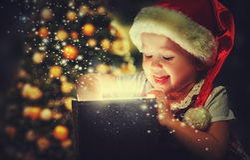 Christmas miracle, magic gift box and child baby girl Stock Photos